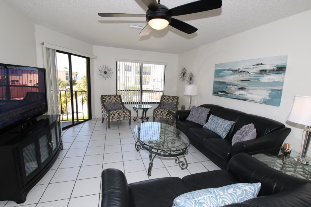 Living Room with Large Flat-screen TV - Perrywinkle - 2 Bedroom Condo - Anna Maria Island Beach vacation Home - Homes4uu