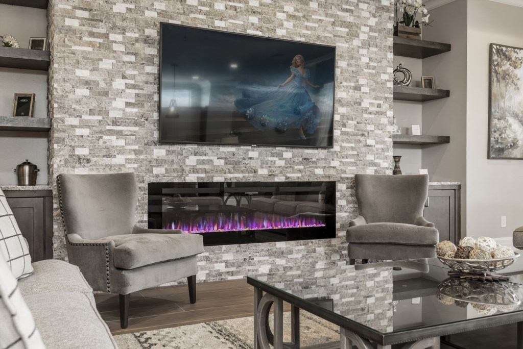 Fire Place And TV - Pirate's Utopia - 10 Bedroom Disnay Area Custom MansionVacation Home - Homes4uu